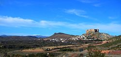 View of Mesones de Isuela town with the Sierra de Nava Alta in the background and the Moncayo Massif covered in snow in the distance.