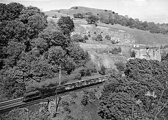 Millers Dale railway station - Millers Dale, with Down freight passing in 1957