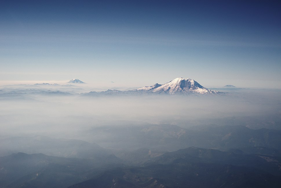 Mount Rainier and other Cascades mountains poking through clouds