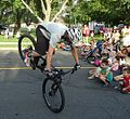 Mountain bike cyclist Chris Clark demonstrates a maneuver.jpg