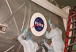 NASA logo is placed on the U.S. Lab for STS-98 (KSC-00PP-1930).jpg