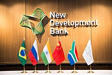 Bank's logo and BRICS flags