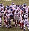 NY Giants huddle (6837597501).jpg