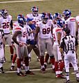 NY Giants huddle (6837597501).jpg