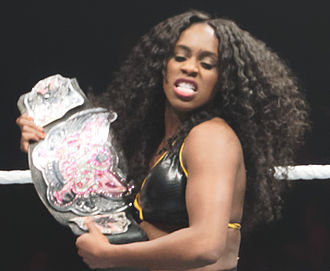 Naomi (wrestler) - Naomi holding the Divas Championship during a WWE house show in April 2015.