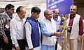 Narendra Singh Tomar lighting the lamp at an event to celebrate the two years of District Development Coordination & Monitoring Committee (DISHA) initiative with StatesUTs, in New Delhi.JPG