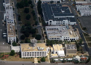 United States Naval Research Laboratory - Part of the NRL complex seen from the air above the Potomac River in 2012.  The part of the campus shown contains the oldest five buildings on the campus.