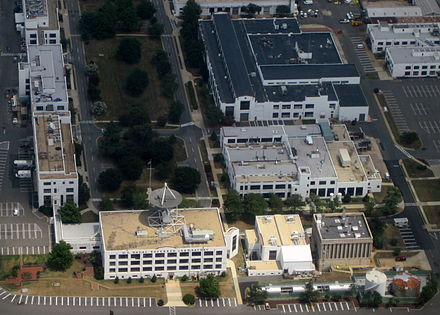 An aerial view of the NRL complex in 2012. The area shown contains the oldest five buildings on the campus. NavalResearchLab.jpg