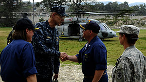 United States Fourth Fleet - Commander, Task Force 41, Rear Admiral Thomas, shakes hands with Commanding Officer, USS Gunston Hall, in Haiti, after the earthquake there
