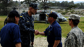 United States Fourth Fleet - Commander, Task Force 41, Rear Admiral Thomas, shakes hands with Commanding Officer, USS Gunston Hall, in Haiti, on 5 February 2010. Fourth Fleet units were deployed to assist after the earthquake there.
