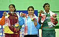 Nikki (India) winner of Gold Medal in 75kg Women's wrestling with Silver medallist WPCKR Weerasingh (Sri Lanka) and Bronze medallist Min Khutan (Bangladesh), during the presentation ceremony.jpg