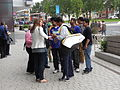Niluka Karunaratne signing autographs for fans (London 2012 Olympics).jpg