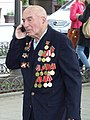 Old Soldier with Cellphone - Victory Day - Odessa - Ukraine (26825463512).jpg