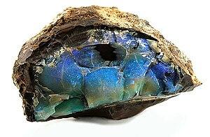 Opal - A rich seam of irridescent opal encased in matrix