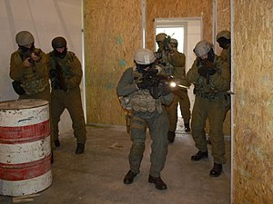 Close quarters combat - Operators of Hungarian Army's KMZ enters a room while attacking the unit's killing house. Note that the first attackers have taken the room's two corners closest to the entry point at first, while the second group continues the attack towards the next room.
