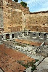 Ancient precursors of modern unisex toilets: latrines in ancient Rome had no partitions and were sex-neutral[5]