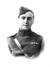 Head-and-shoulders portrait of young man in military uniform with forage cap and pilot's wings above a single ribbon on left breast pocket