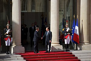 Élysée Palace - Former presidents Nicolas Sarkozy and François Hollande, surrounded by Republican Guards, in the interior court during the  ceremony of transmission of the mandate in 2012.