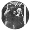 PSM V82 D011 A polish mother holding up her baby for the doctor at ellis island.png