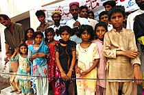 Pakistanis wait for aid at an internally displaced person settlement Aug. 25, 2010, in Pakistan 100825-A-KI401-024.jpg
