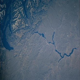 Patagonian Desert - Astronaut photography of the Patagonian Desert (most of the view) contrasted with the Limay River, seen flowing eastward from the Andes.