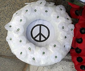 Peace Pledge Union - A Peace poppy wreath, made of Peace poppies, with a CND symbol inside at a British Remembrance Day event