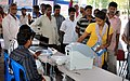 People enthusiastically watching demonstration of VVPAT (Voter Verification People Audit Trial) and EVM.jpg