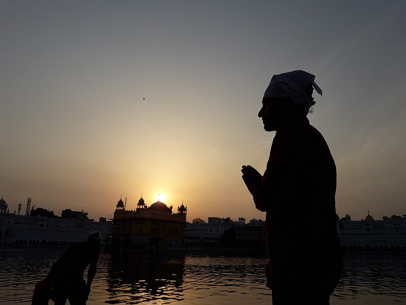 File:Person praying at Golden Temple in Amritsar.jpeg