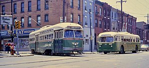 Philadelphia Transportation Company - A PCC-type trolley and a Brill trackless trolley of PTC, wearing the company's standard paint scheme of green-and-cream in 1968.