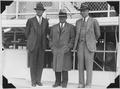 Photograph of 3 men in suits participating in the Alma, WI dam dedication. - NARA - 282433.tif