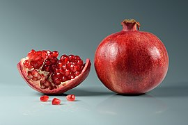 Pomegranate fruit - whole and piece with arils.jpg