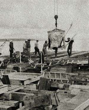 Port of Anchorage - The first concrete being poured in September 1959.  Initial construction was delayed first by the loss at sea of most of the pilings, followed by a strike by carpenters.