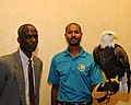Posing for picture with Bald Eagle. (10595005414).jpg