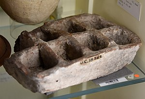 Kurna - Pottery tray with 8 compartments. Redware, rectangular. 11th Dynasty. From Kurna (Qurnah), Egypt. The Petrie Museum of Egyptian Archaeology, London