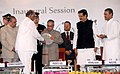 """Pranab Mukherjee being presented a memento by the Union Minister for Agriculture and Food Processing Industries, Shri Sharad Pawar, at the inauguration of the """"Krishi Vasant"""" agriculture exhibition.jpg"""