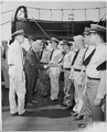 President Harry S. Truman received the officers of the U. S. S. Augusta on the well deck. Commander C. L. Freeman... - NARA - 198732.tif