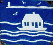 A square, royal blue ceramic plaque, with a white-line design etched into it, depicting Long Point Light, in the background, and a boat floating a house on the water.