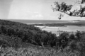 Queensland State Archives 2047 Main Pacific Highway from Reservoir Hill Burleigh Heads showing Tallebudgera Creek Currumbin Coolangatta and Tweed Heads in the distance c 1934.png