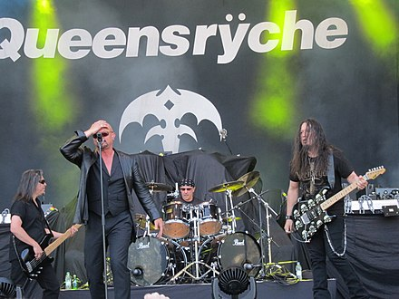 Queensryche performing at the Sauna Open Air Metal Festival on June 11, 2011, in Tampere, Finland. Left to right: bassist Eddie Jackson, lead vocalist Geoff Tate, drummer Scott Rockenfield, and guitarist Michael Wilton. Queensryche, paalava, Sauna Open Air 2011, Tampere, 11.6.2011 (30).JPG