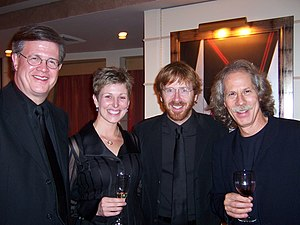 Ray Reach - Left to right: Ray Reach, Carla Stovall, Trey Anastasio, and Lou Marini at a reception following a Carnegie Hall concert, 2004