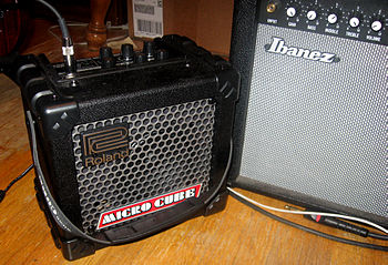 English: A Roland Micro Cube, next to an Ibane...
