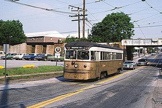 Clifton–Aldan station - The Route 102 Trolley to Sharon Hill emerges from the bridge over Springfield Road in 1976.