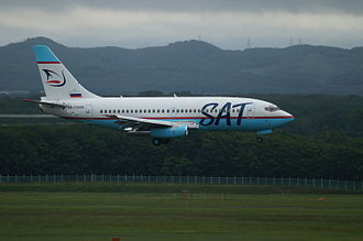 SAT Airlines - A SAT Airlines Boeing 737-200 landing at New Chitose Airport, Japan. (2006)