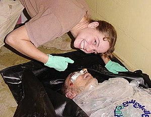 Sabrina Harman - Sabrina Harman posing over the body of Manadel al-Jamadi, an Iraqi prisoner who was tortured to death in United States custody during interrogation at Abu Ghraib prison in November 2003