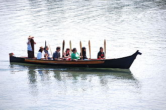 Indigenous peoples of the Pacific Northwest Coast - A canoe awaiting traditional invitation to make landfall by the local S'Klallam people at a beach in Port Angeles, Washington, in 2010. Canoes from several Coast Salish groups arrived for a ceremony commemorating the official naming of the Salish Sea.