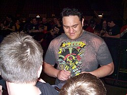Samoa Joe signing autographs for fans