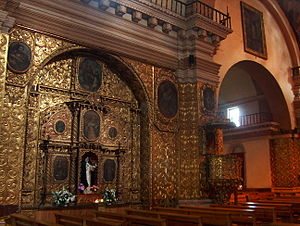 San Cristóbal de las Casas - One of the gilded panels inside the Santo Domingo Church
