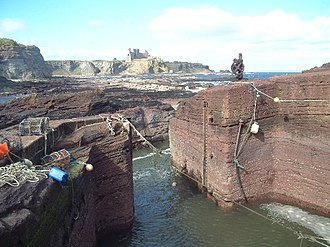 Tantallon Castle - View from Seacliff Harbour, showing the fortifications blocking the promontory