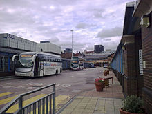 The central area of Sheffield Interchange. Visible are National Express, First South Yorkshire and Stagecoach services.Also visible is the Archway centre (the main block of the interchange) and the Odeon cinema (left)