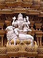Shiva and Parvathi sculptures in stucco on gopura of Srikanteshvara temple at Nanjanagudu.jpg